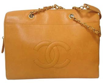 Vintage CHANEL orange yellow caviar leather chain shoulder large tote bag with golden chains and large CC stitch mark.