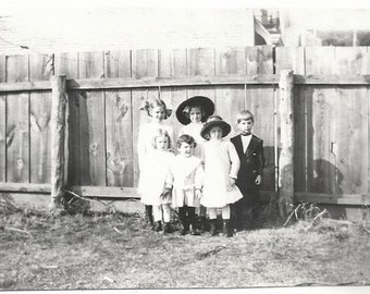 Old Photo Group of Dressed Up Children by Fence Girls Boys Hats 1910s Photograph Snapshot vintage