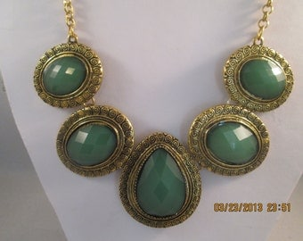 Gold Tone and Green Pendant Necklace on a Gold Tone Chain