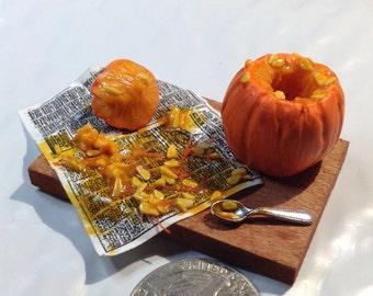 Miniature pumpkin carving scene