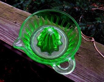 uranium green glass orange reamer, juicer, arched design