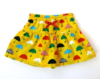Girl's corduroy winter skirt with shorts underneath, yellow with umbrellas