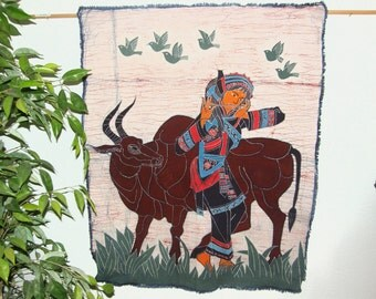 Miao Woman with Flute and Water Buffalo wall hanging - Vintage Chinese batik made in Guizhou Province