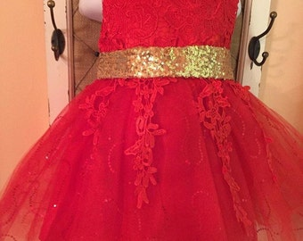 Red dress with gold bow on back