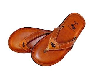 de Leon Tan Flip Flops for women