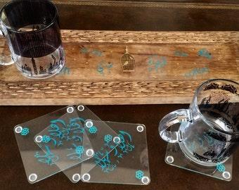 Wooden serving tray with metal golden metal handles.