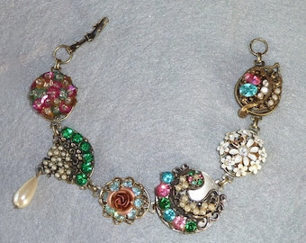 Vintage Collage Bracelet in rich jewel tones made from vintage rhinestone and pearl jewelry