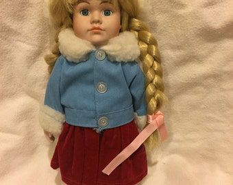 Great buy on this vintage porcelain doll.  Dressed and ready to go skating with her new mommy!