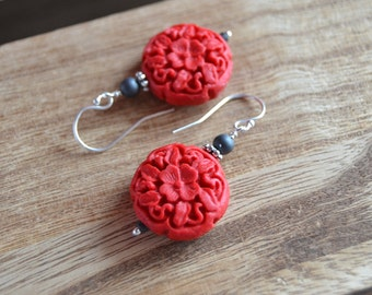 Scarlet floral cinnabar dangle earrings with sterling silver french hook ear wires.