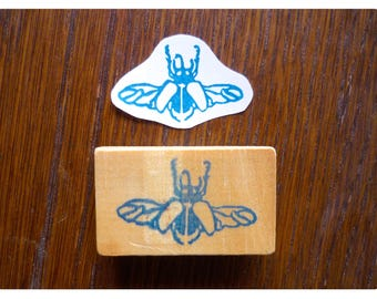 Rubber stamp little beetle flight