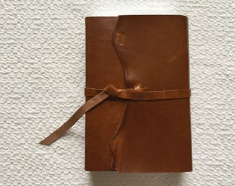 NIV Study Bible  custom recovered covered cowhide leather with strap