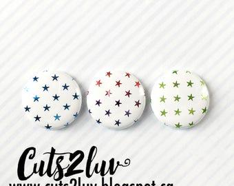 "3 badges 1 ""blue metal stars, multi tones *, green"