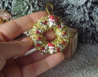 Dollhouse santas christmas wreath. 1:12 miniature children wreath for dollhouses. Miniature christmas decorations for dollhouses.