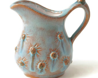 Perfect Little Pottery Jug hand made from earthenware and decorated in white and aqua.