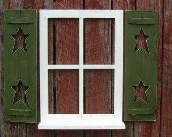 "Window with shutters and shelf, stars in shutters 31-1/2"""" wide 24-1/2"" high"