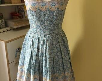 Vintage style handmade cotton sundress with circular pattern fabric. UK size 8/10