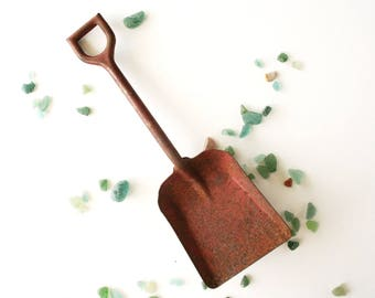 Vintage toy shovel, rusty metal shovel, red toy shovel, toy sand shovel