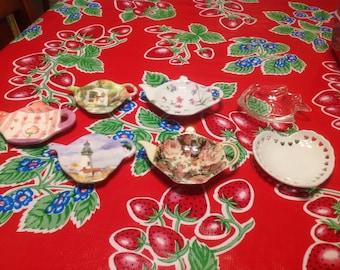 Vintage set of ceramic, glass, and plastic tea bag holders or caddies