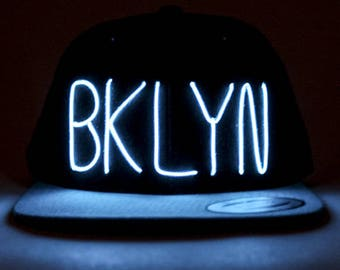 Light Up BKLYN (Brooklyn) Hat made with El Wire in all colors; blue, green, orange, yellow, pink, purple, white