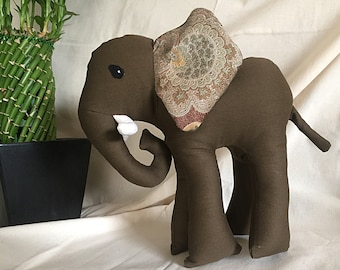 Darling 14 inch stuffed brown toy elephant with embroidered ears.