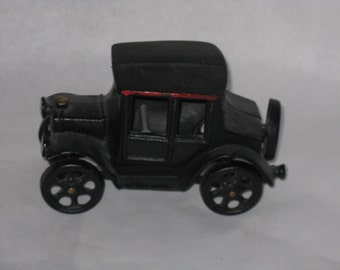Small vintage metal car toy figurine