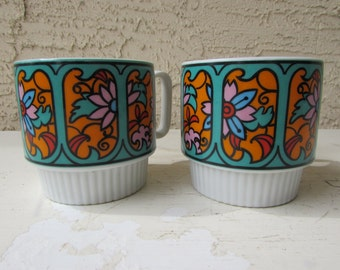Set of 2 Vintage Coffee Mugs- Floral Mugs Groovy 60's 70's Stained Glass floral - Oranges, Teal and Pink on White. Mann Made Mug - Stacking