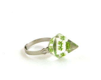 Transparent with green mini pressed flowers faceted pyramid resin ring.