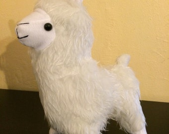 White faux fur stuffed llama plush