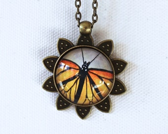Monarch Butterfly in Sunflower Pendant Necklace Antique Brass Finish Necklace