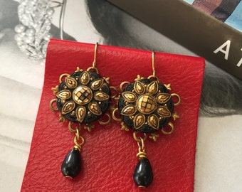 Vintage black and gold glass button earrings.