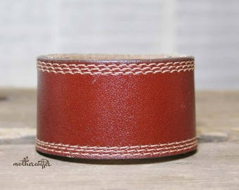 CUSTOM HANDSTAMPED saddle brown leather cuff with stitching by mothercuffer