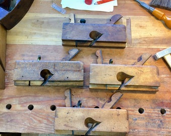 Group of four wooden dado planes