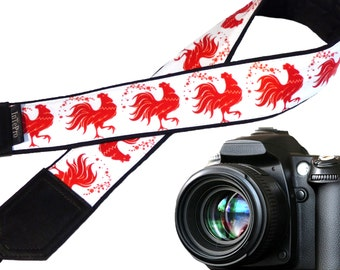 Red rooster camera strap. Fire Rooster. Symbol 2017. New Year gift. Stylized cock. Padded camera strap. Red and white. Camera accessory.