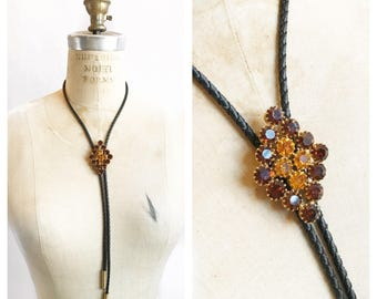 Amazing glitzy diamond bolo tie with amber toned crystals.