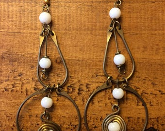 Gold African earrings with white beads