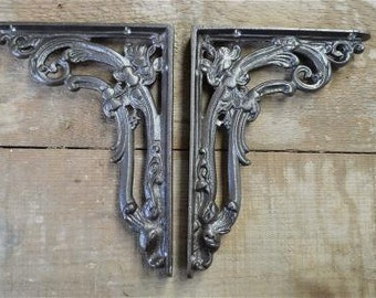 A pair of antique style cast iron foliage brackets AL19