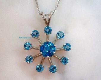 14K White Gold Sky Blue Topaz Snowflake Pendant On Chain