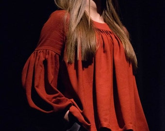 Brick, dark orange blouse, folded sleeves
