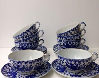 Set of eight vintage Asian tea cups of fine porcelain