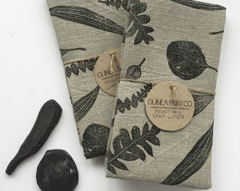 natural linen kitchen tea towel black on flax botanical leaf blockprint.