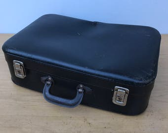 Old suitcase travel year 1950 Vintage black trunk