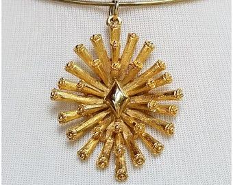 Large gold tone spiky sputnik pendant