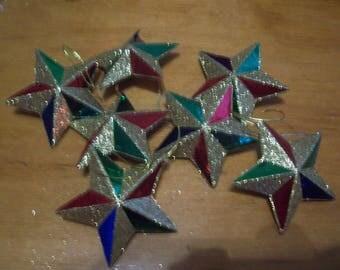 Seven Hard Plastic Star Christmas Ornaments