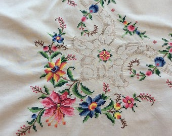 Beautiful vintage white tablecloth with embroidery and cutwork.  64 x 48