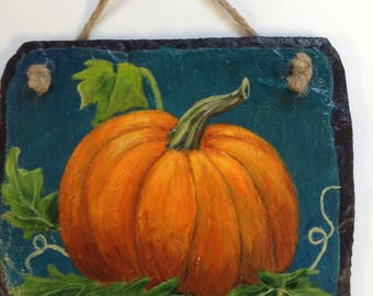 "An original pumpkin painting on slate in acrylic .  Price 14.00  Size 6"" x 5"" ."