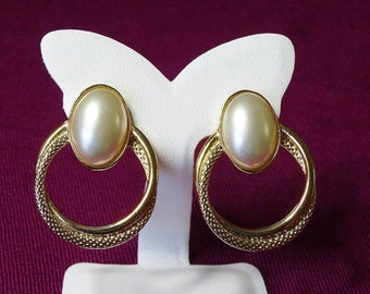 Vintage Pierced Earrings Oval Cabachon Ivory Faux Pearl Centre Sitting at Top of Gold Tone Double Loop Circles Textured and Plain Gloss