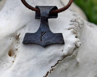 Thor's Hammer necklace, available with custom viking runes. Sold with reindeer leather or black cotton thread.