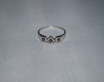 Sterling silver ring size 9 with amethyst setting.