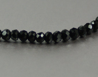 Chinese Crystal Tiny Rondelles in Jet Black Strand 2x3mm