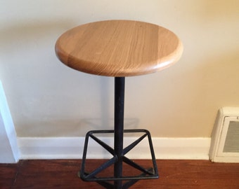 A Vintage Industrial style stool. Drafting Stool.